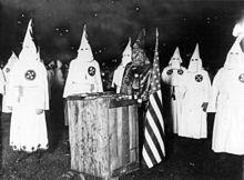 220px-KKK_night_rally_in_Chicago_c1920_cph.3b12355